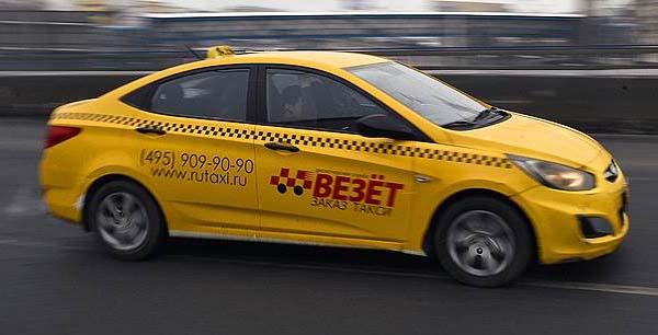 Машина компании такси Везет